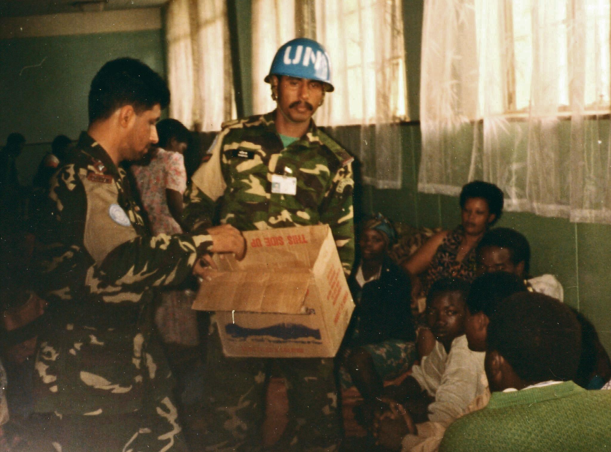 Providing supplies to Tutsi refugees - Amahoro Stadium, Kigali, April 1994