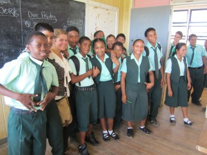 One of the volunteers with her class in Port Kaituma
